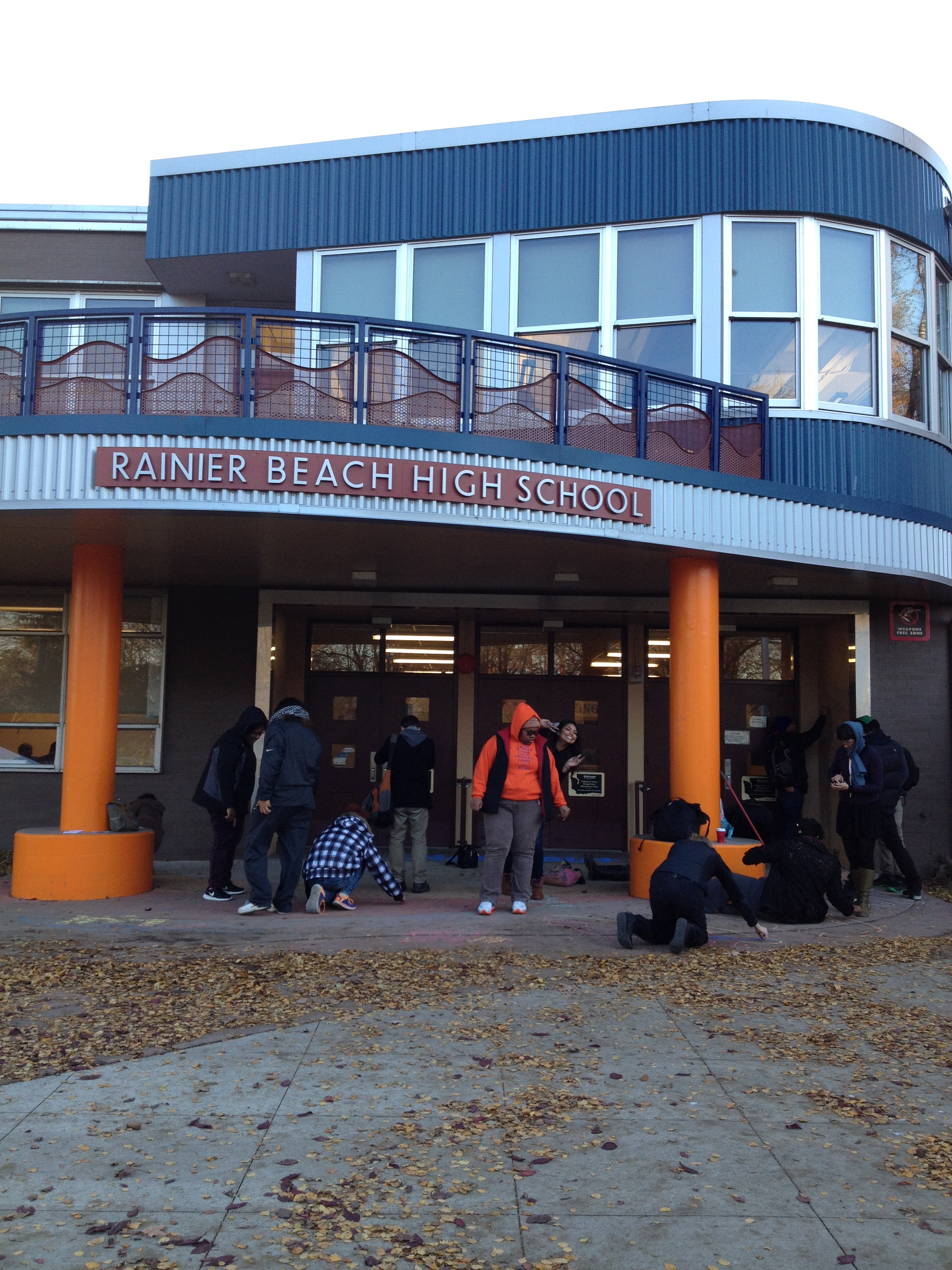 """Rainier Beach students gather outside the school for a """"chalk out."""" Photo Credit: drea chicas"""