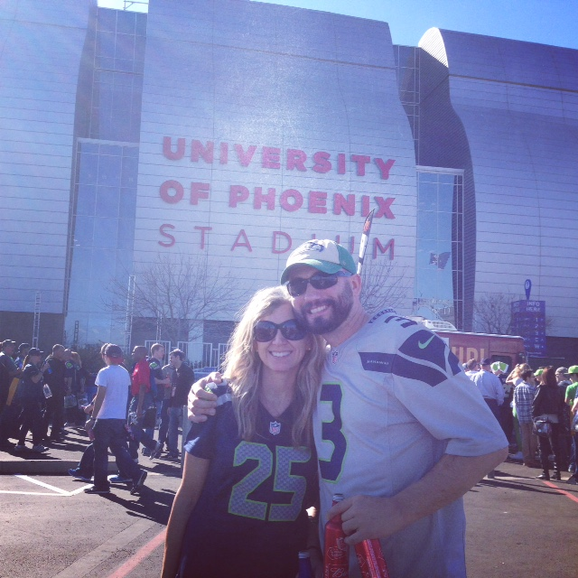 Susan outside University of Phoenix Stadium (cite of the Super Bowl) with husband Darrin. Photo Courtesy Susan Dodds Ruder.