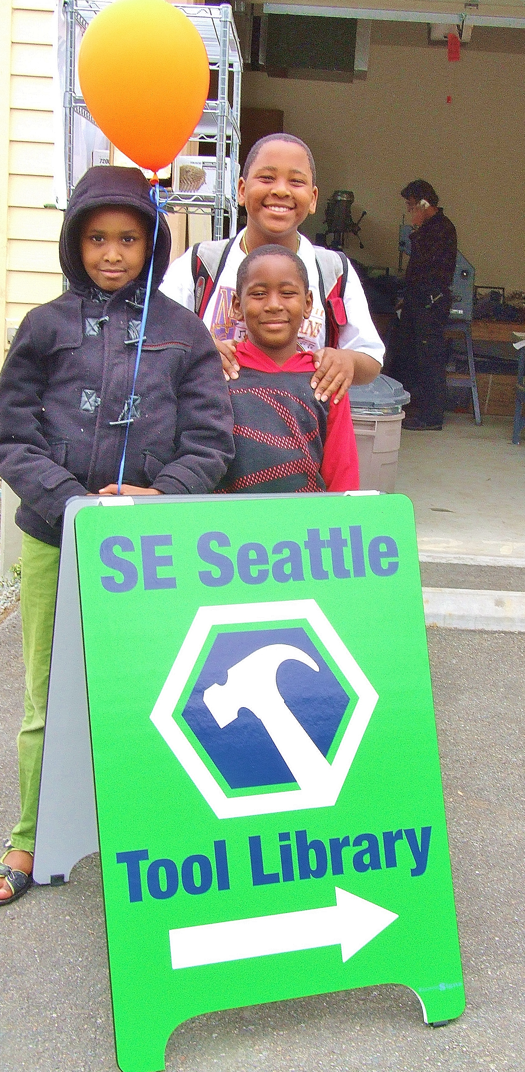 Residents at the Southeast Seattle Tool Library Grand Opening