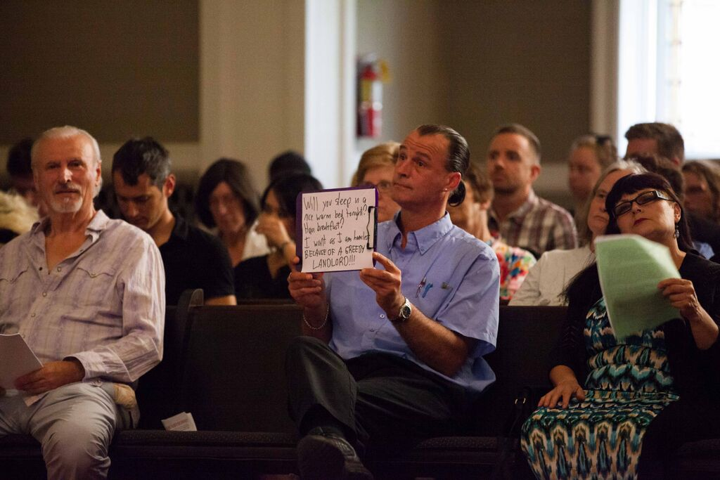 A pro rent-control advocate makes his feelings known during the debate. Photo Credit: Alex Garland