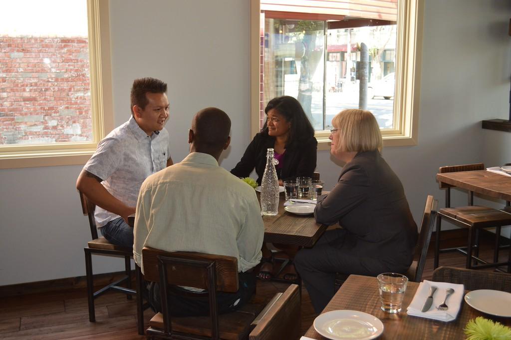 Senator Patty Murray speaks with Salted Sea owner Huy Tat, as 37th District State Senator Pramila Jayapal looks on.