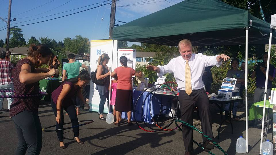 Seattle Mayor Ed Murray hula-hoops as  Jenny Frankl from the Department of Neighborhoods looks on.