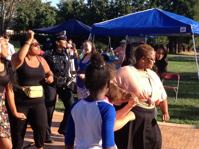 "Community members do the ""wooble"" during the festivities. Photo Credit: Reagan Jackson"