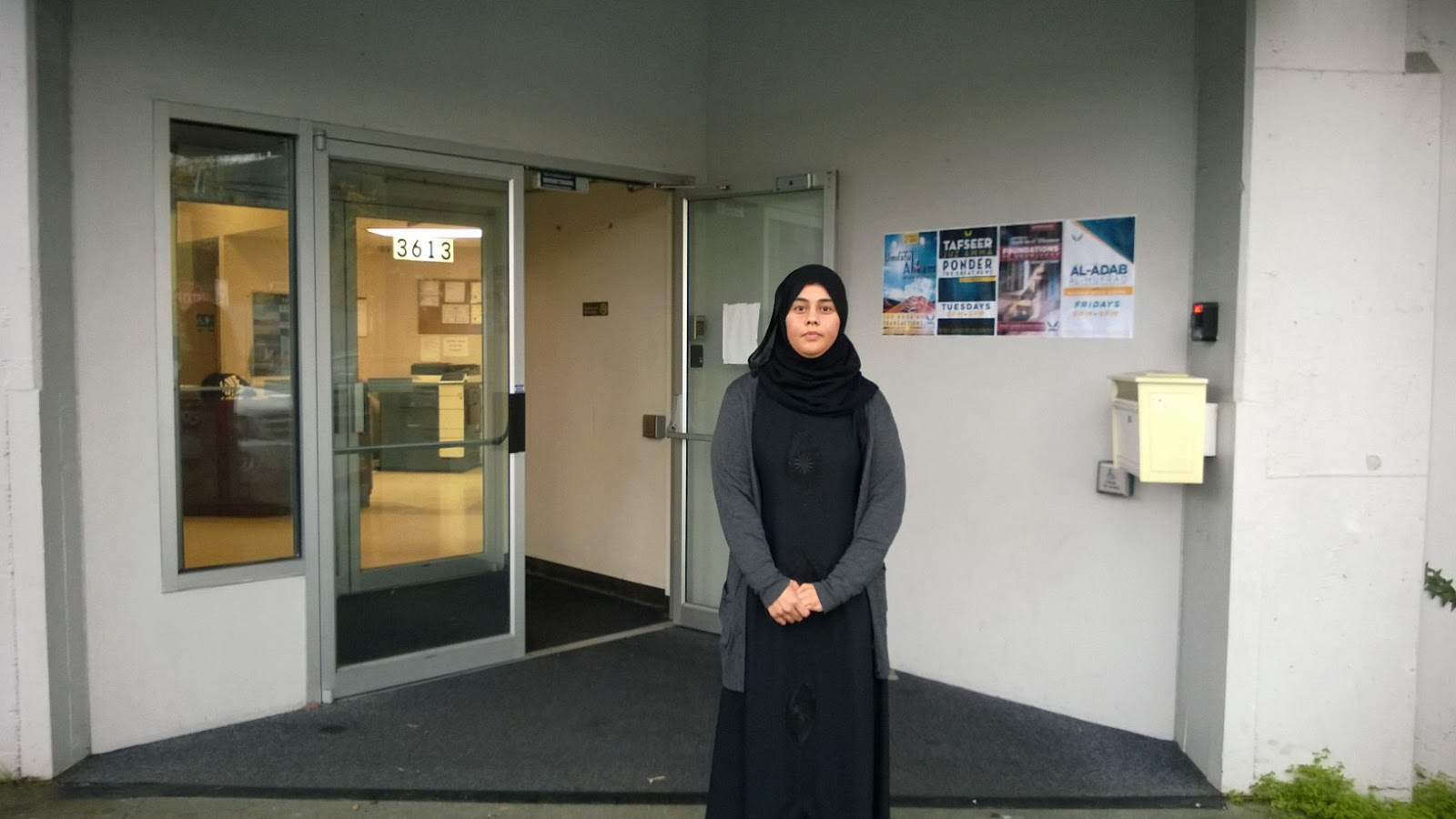 Aishah Bomani standing in front of Makkah Islamic School entrance, Nov. 9. (Photo by Danish Mehboob)
