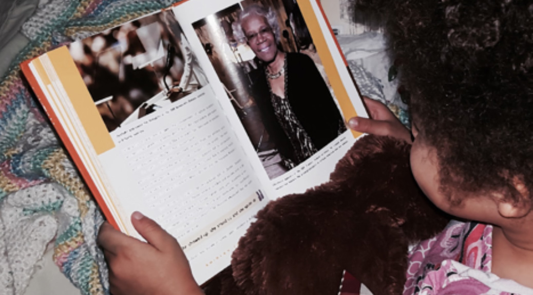 Child reading about Shirley Chisholm - Photo by AJ Beard