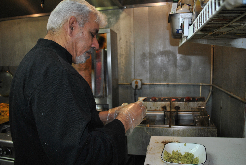 Owner Rami Al-Jabori makes falafel